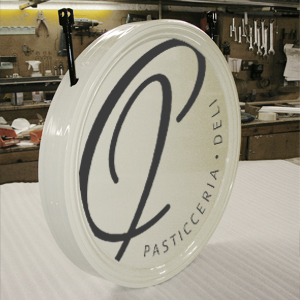 Vinyl graphics applied to circular shop sign