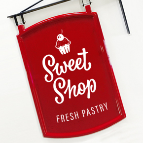 Vinyl graphics applied to shop swing sign